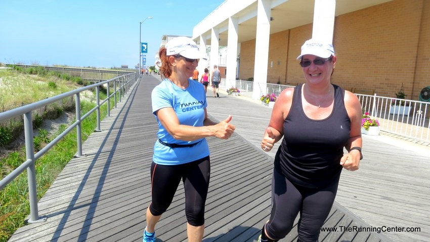 Coach Mindy coaches runner on boardwalk 2015