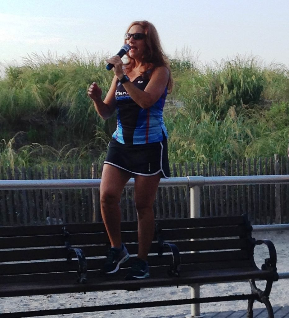 Coach Mindy leads warm-up on boardwalk 2015