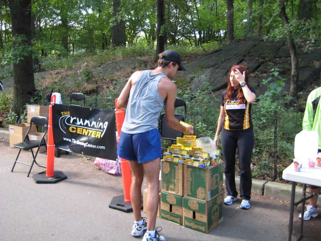 Coach Mindy with runner at energy food table at long run 2008